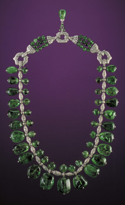 Catalogue number G5023, the Post emerald necklace. The necklace exhibits 24 baroque-cut emeralds and matching emerald beads set in a platinum and pave diamond necklace designed by Cartier, Inc., in 1928 to 1929. The necklace combines elements of both the Art Deco style and popular Indian influences of the period. The necklace was donated to the Smithsonian Institution National Museum of Natural History by Mrs. Marjorie Merriweather Post in 1964. Image file previously labeled Disc 3 EmrldSaphRuby 004.