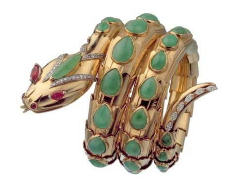 """Snake"" bracelet in gold with jade, rubies and diamonds, 1968. The bracelet is designed as a coiled snake, in 18kt yellow gold, weighing gr. 126.28, set with the following gemstones: the head is set with: 46 circular diamonds, eight-eight cut, average estimated weight 0.01 ct., total approximate weight circa 0.46 ct.; 2 circular cabochon rubies, estimated weight 0.10 ct. each, total approximate weight circa 0.20 ct.; 2 marquise-shaped rubies, mixed cut, estimated weight 0.40 ct. each, total approximate weight circa 0.80 ct; 1 marquise-shaped cabochon jadeite, estimated weight circa 1.20 ct.; the coils of the serpent are set with : 43 pear-shaped cabochon jadeites of differing weights, the smallest of 0.20 ct. the largest of 1.75 ct., total approximate estimated weight 44.00 ct; the tail is set with: 6 marquise-shaped diamonds of modified brilliant-cut, estimated average weight 0.05 ct. each, total approximate weight 0.30 ct. Marks: on the reverse of the tail: ""BVLGARI"" engraved; on the reverse of the head: oval (illegible), ""750""."