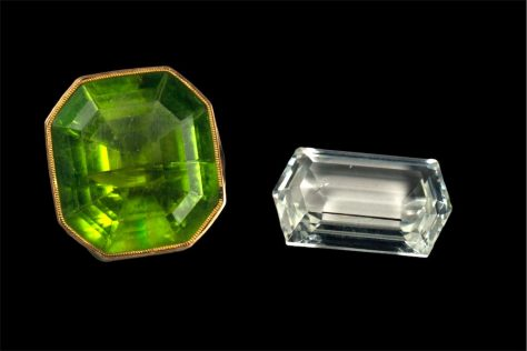 DSC_9130b facetted green peridot (20 ct) from Egypt (18th century) and colorless forsterite (10 ct) from Tajikistan (21st century)